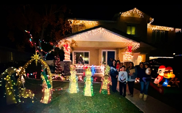 Pictured are this year's Holiday Yard of the Year winners: (l-r) Annette Cardona, Kamrie Cardona, Noah Halcon, Ari Larson of Fillmore Civic Pride, Brittany Halcon and Alani Halcon.