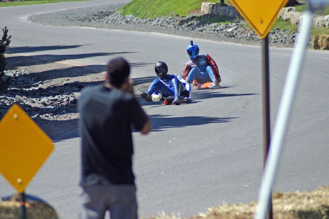 Conaway leading organizer and fellow racer Chris Hicks down the Windham race course and into Crash Corner.