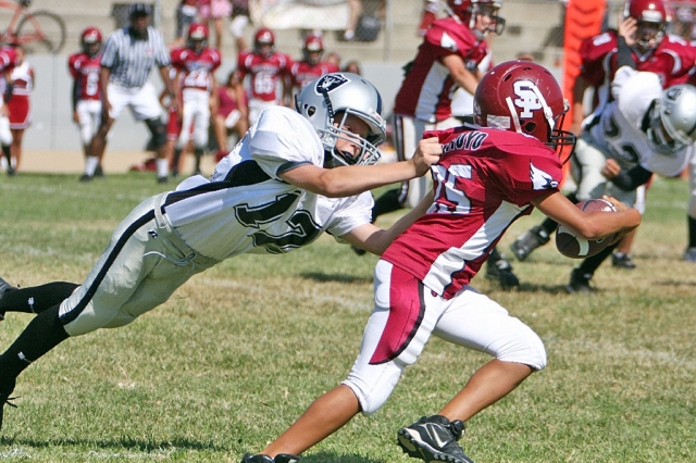 Aaron Cronin taking down a Cardinal ball carrier.