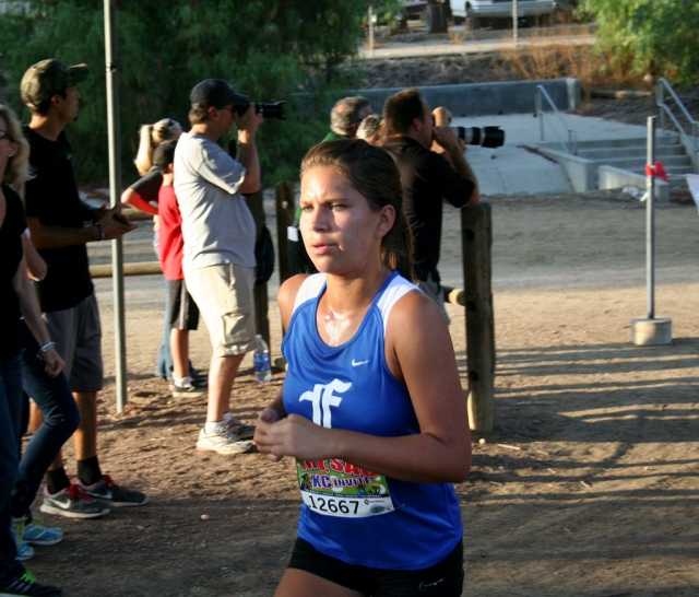 Fillmore Varsity Girl Jordyn Vassaur preparing for poop out hill at the Mt. Sac Invitational this past Saturday. Jordyn was the third Fillmore athlete for the Lady Flashes to Kiana Hope and Lupita Perez. She has been an integral part of her team's success. Her willingness to work hard in practice and in the meets has helped in pushing her team forward in the right direction. Keep up the good work Jordyn, your coaches and teammates are proud of you.
