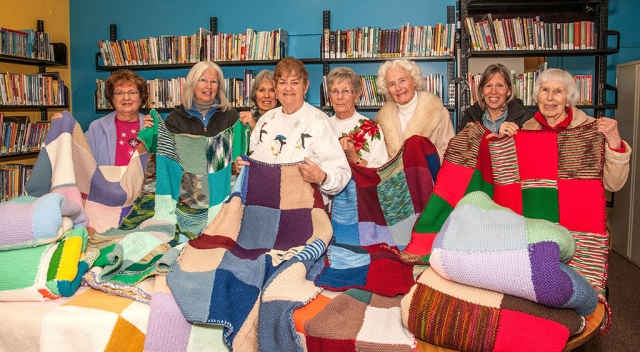 Knitters (l-r) Joan Padilla, Kit Willis, Silvia Basich, Sue Dickens, Sally Dunio, Carolejo Adams, Lanae Carter and Alyce Barnwell. Other knitters not pictured are Nancy DeGroot, Marge Hatton and Charlene Hartenstein.