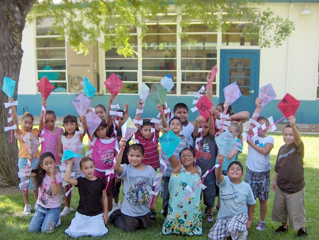 "Third grade students at San Cayetano School have started reading stories with friendship as a theme. We read the story: Gloria Who Might Be My Best Friend by Ann Cameron. Through a series of small events, two young children begin a friendship. Gloria moves to the same street that Julian lives on. Gloria explains to Julian that if you write your wishes on a piece of paper and put them in the tail of your kite, the wishes will come true if the papers are gone when you bring the kite down. Here are Mr. Kwit's third grade students with the kites and wishes that they made. Wishes ranged from ""I wish Fillmore was sparkly clean!"" to ""I wish my family was rich!"""