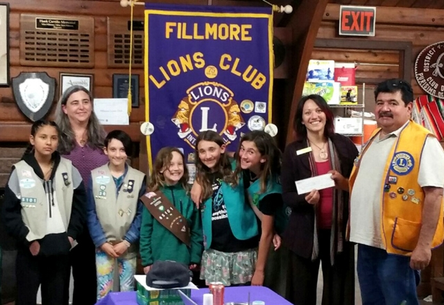 The Fillmore Lions Club presented a $300 check to Fillmore Girl Scout Troop 65101 to attend camp. Pictured left to right is Heather Merenda, Diamond Mendoza, Aurora LaRaia, Mable Lengning, Aine LaRaia, Rosetta Merenda, Brandy Lengning, and Ed Barajas of the Fillmore Lions Club. Courtesy Jan Lee.