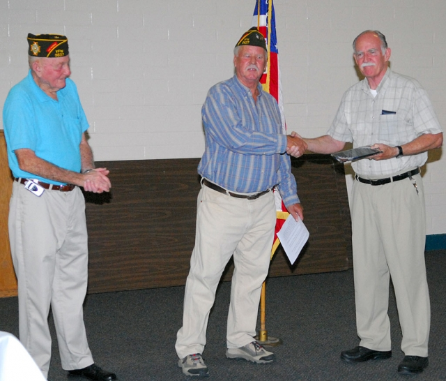 Fillmore Gazette publisher Martin Farrell received a plaque Tuesday night from the Veteran's of Foreign Wars Post 9637 for his support and dedication to the VFW. Left to right, John Pressey, Victor Westerberg are shown with Farrell.
