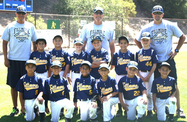(l-t) (front row) Nathan Delgadillo, Jathan Magana, Mathew Magana, Nathan Perez, Joel Contreras and Theodore Ebell, (back row) Coach Pepe Munoz, Roman Munoz, Jarod Uridel, Ty Morris, Manager/Coach Terry Morris, Phillip Cervantez, Johnny Cardenas, Ty Weeks and Coach Ryan Weeks.