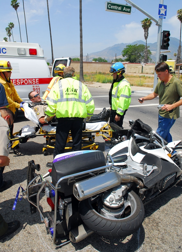 Sheriff's Deputy Tony Biter suffered minor injuries following a traffi c collision at the intersection of Hwy. 126 and Central Ave., Monday. A motorist accidentally turned in front of his motorcycle. He is recovering at home.