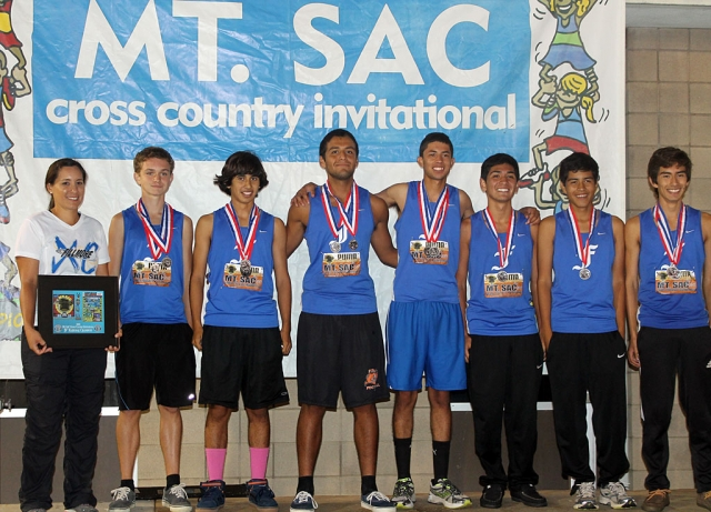 JV Boys National Championships (Division IV) (l-r) Ms. Tafoya, Justin Beach, Frank Chavez, David Enriquez, Jovani Oregon, Sammy Martinez, Mario Gaspar and Vincent Chavez.
