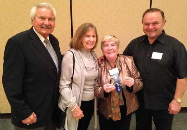 Nan Drake holds the Pacific Coast Business Times award. She is with (from l-r) Harrison Industries President Ralph Harrison, his wife Jenny and Harrison Vice President Jim Harrison.