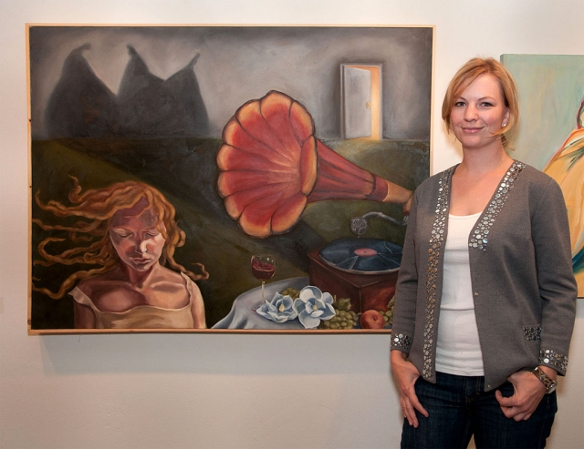 "Ashleigh Norman of Fillmore with her award winning painting, ""The Message."" Photo by Myrna Cambianica."