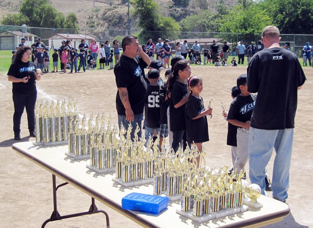 Children were presented with trophies at closing ceremonies in Piru. (Photos courtesy Andy Arias)