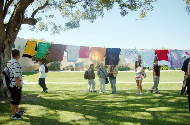 Students and other members of the community make t-shirts to honor those hurt by domestic violence, date rape and other forms of anger at the Clothesline Project at Ventura College.