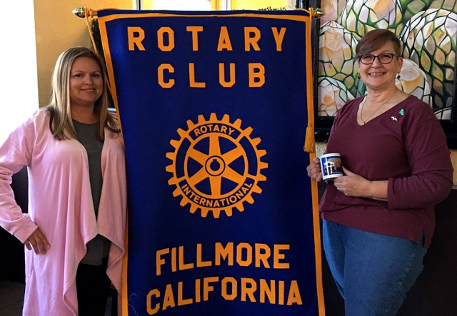 "Pictured (l-r) is Rotary Club President Ari Larson presenting Lisa Merkord with a Rotary mug as a thank you for coming out to share her story with the group. Lisa calls herself a ""backyard keeper"" of bees and if you have a swarm of bees she will come and take them away. She gave a very informative program on all aspects of bees, from their life cycle, to jobs of bees inside the hive, to which honey is the best for our health. She was very knowledgeable and an excellent speaker. Courtesy Martha Richardson."