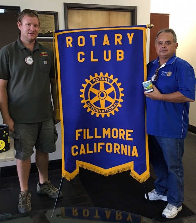 (l-r) Rotary Club President Andy Klittich presenting Ernie Villegas with a mug to recognize all the time he has dedication he has put into the Designation Fillmore program. Photo courtesy Martha Richardson.