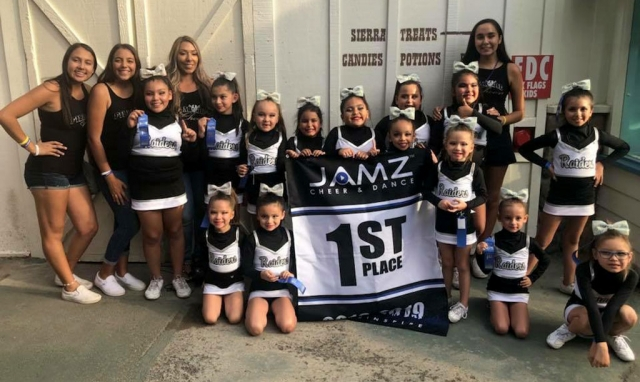 Sunday, November 4th th Fillmore Raiders Youth Cheer took 1st place at Jamz Regional Competition which was held at Six Flags Magic Mountain. This qualifies the team for the Jamz Nationals which will take place in Las Vegas in January 2019. It has been three years since the Raiders last competed. Pictured below top left: Ciera Cervantes, Aliyah De Lara, Lucia Mynatt, Kamille Murillo, Alynna Perez, Jaylene Ponce, Myla Puebla, Stevie Magana, Isabella Mynatt, Destiny Cortez. Bottom left: Noelle Magana, Malia Moore, Anli Collins, Elianna Murillo (not pictured: Rayne Celestina) Trainers: Jazmine Chavez, Aneesa Valencia, Angelina Mynatt, and Daisy Andrade. Head coach: Brianna Acosta Team mom: Irene Mynatt. Photo courtesy Coach Brianna Acosta.