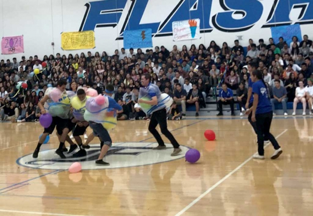 Friday, August 25th, Fillmore High School hosted their Welcome Back Rally. The theme was the Olympic Games. Students are throwing a noodle through the hula hoop rings and students and faculty are playing the balloon