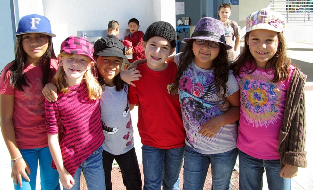 "Mountain Vista students Stephanie Romero, Maddie Davis, Lexie Garza, Jillian Graves, Liliana Contreras, and Anahi Nuno show their Red Ribbon Week spirit by ""Putting a Cap"" on drugs."