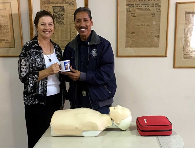 Julie Latshaw Rotary President, presented a mug to Al Huerta who gave a program on the updated methods of CPR and explained how to use the mobile defibrillator.