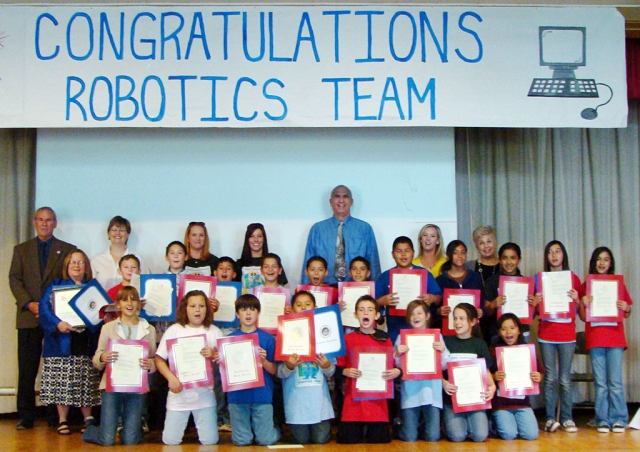 "Pictured is the San Cayetano Robotics Team with ""Special Friends"" at an awards assembly honoring the new innovative program. One team took 1st place and another team took 4th place in a competition at JPL March 17, 2009. The competition was for NASA Explorer Schools for Southern California. The ""Special Friends"" in the picture include : Jan Marholin, Principal San Cayetano, Ota Lutz Education Coordinator for NES Schools JPL, Mr. Stan Mantooth, Superintendent Ventura County Schools, Mr. Jeff Sweeney, Superintendent FUSD, Mrs. Linda Johnson , Representative for Senator Runner, Mrs. Dana Nielsen, Representative for Assemblymember Strickland. Next year San Cayetano hopes to expand the program into the third grade as currently it is offered in the fourth and fifth grades."