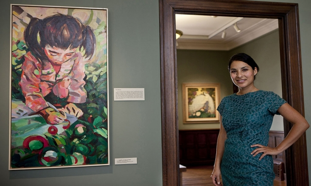 "Andrea Vargas and her painting ""Angelita"", acrylic on wood."