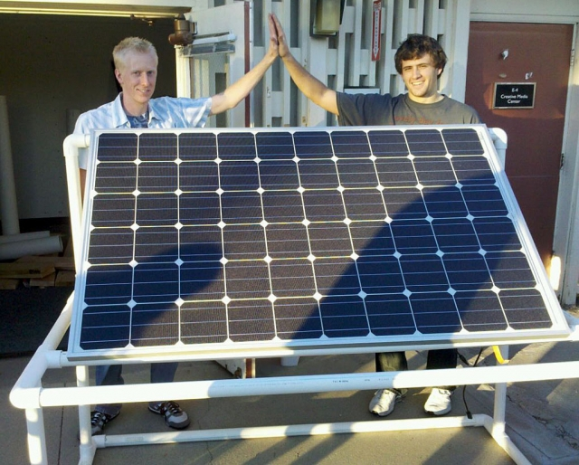 Sophomore bioengineering majors Josh Miller of Escondido and Zach Flagg of Meadow Vista display the solar panel and pipes the students put together for the fountain.