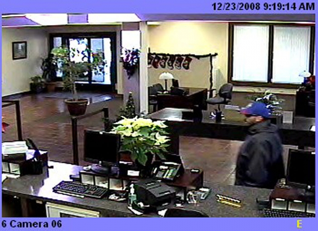 WANTED: Hispanic male, unshaven, mid-to-late 20's. (Photo #1 - Suspect entering bank).