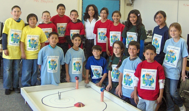 Veronica Morris owner of Water Art Design stands with the San Cayetano Robotics students in T-Shirts that she created for the team. Two teams of four students will compete on March 17th at JPL in Pasadena. The students worked after school starting in January and the students picked which of their peers would represent them at the competition. Fillmore Sunrisers Rotary donated funds to take care of transportation and incidentals for the one day competition . This is truly exciting for San Cayetano to be part of this new adventure.