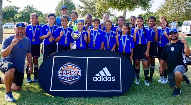 Pictured above is the California United U-12 Girls Team which has advanced to the Championship in the VC Fusion Summer Invitational Tournament. (l-r) Lexi Pina, Athena Dunbar, Kim Manriquez, Gabriela Martinez, Kari Terrazas, Marlene Gonzalez, Livi Cabral, Mikayla McKenzie, Tori Pina, Isabel Hernandez, Naomi Tobias, Ashley Hernandez, Fatima Alvarado, Jadon Torres and Anahi Aranda (not pictured, Miley Tello). Coaches Junior Lomeli, Cipriano Martinez and Tony Hernandez. Photo courtesy Tony Hernandez.
