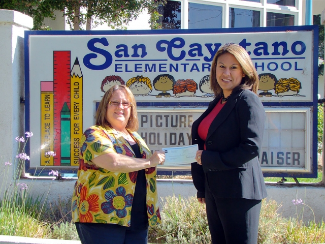 Christie M. Ponce, Branch Manager of our local Wells Fargo is shown handing Jan Marholin, Principal of San Cayetano a check for $4100 to cover the costs of the annual Harvest Festival/Fall carnival. This will be the third year that Wells Fargo has partnered with the elementary schools to host this community event. All profits from the event are split among the elementary staff working the event to be used in their classrooms. The date for the October event this year is Thursday night October 28th from 5-8PM. More details will be available at a later date.