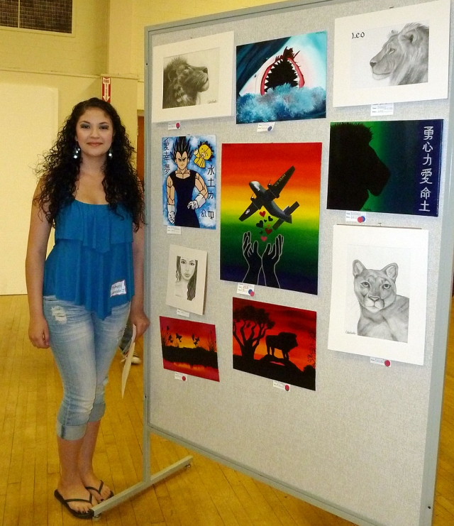 Brittany Gonzalez, a Senior at FHS, stands along side her amazing display of art work at the FHS Art Show held Tuesday, April 12, 2011.