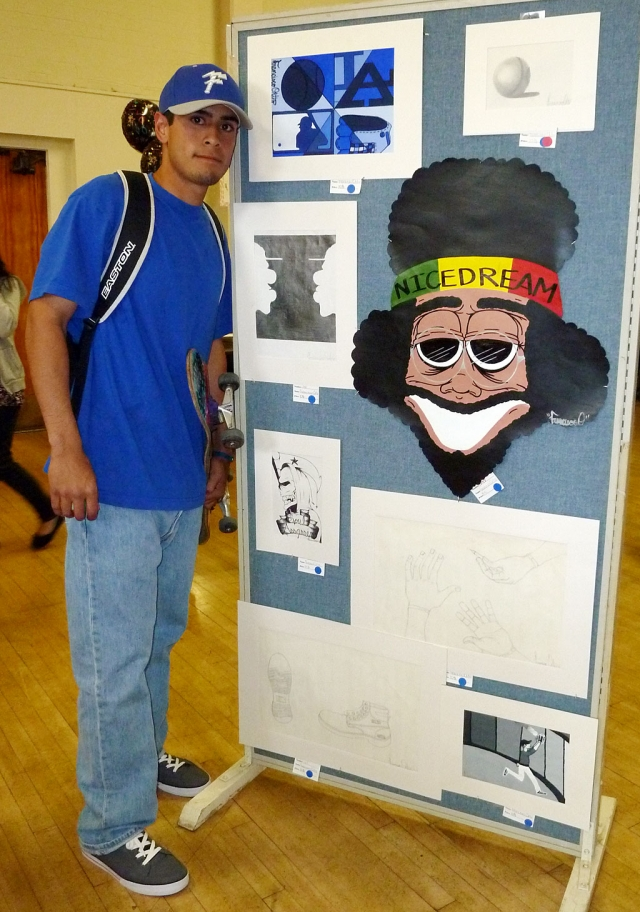 Francisco Ortiz, a Junior at FHS, is very proud of his awesome art work on display at the Art Show.