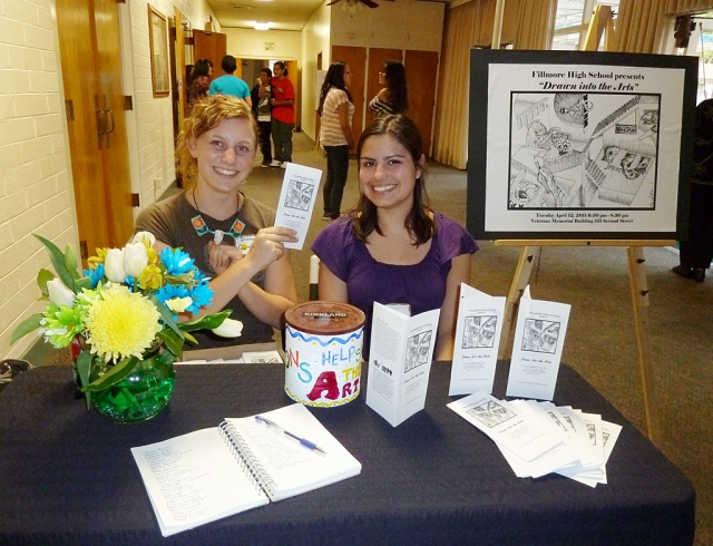 The delightful greeters for the FHS Art Show. (l-r) Diana J. Gumber, Senior at FHS, also the artist who drew the picture for the postcard and brochure and Briana Vazquez, a senior at FHS.