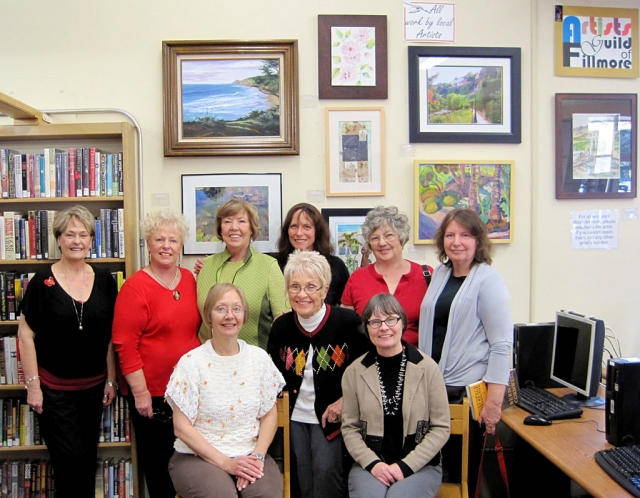 Back row: Artists Guild of Fillmore members Wana Klasen, Luanne Perez, Karen Browdy, Lois Freeman-Fox, Joanne King, Virginia Neuman, and Front row first two: Jan Faulkner and Judy Dressler. They have just shown our Fillmore Library Supervisor, Cathy Krushell, front row far right, their new group of paintings.