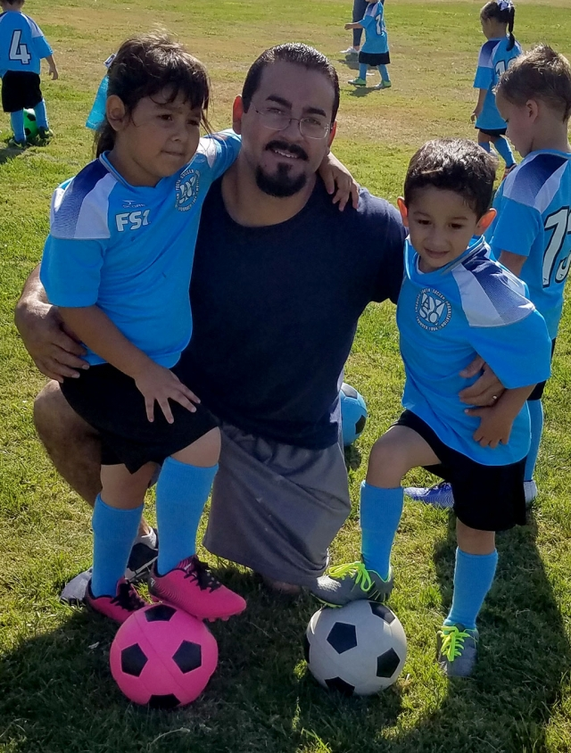 Fillmore AYSO Youth Soccer is in full swing on September 29th the held their 5th week of games at Sheills Park players and at Shiells park in Fillmore. Pictured are two players with their dad enjoying a fun weekend of competition. Photos courtesy Coach Omero.