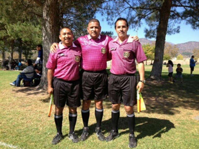 AYSO referees and youth referees showing their support for breast cancer awareness at Shields Park.