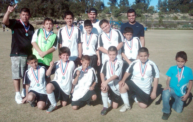 Congratulations to FILLMORE AYSO WHITE TIGERS U-12 team for winning the Championship this weekend defeating Santa Barbara 7-2. They will now go to Bakersfield to represent Ventura/Santa Barbara County in February 2011. Top Row: Coach Shorty Andrade, Anthony Cervantes, Issac Torres, Alex Mendoza, Coach Ernie Alcaraz, Jose Alamillo, Luis Salgado, Coach Andy Diaz. Bottom Row: Christian Andrade, Christian Rosales, Angel Velez, Andy Arana, Jess Ballesteros and Jairo Rios. Way to go Boys!!!