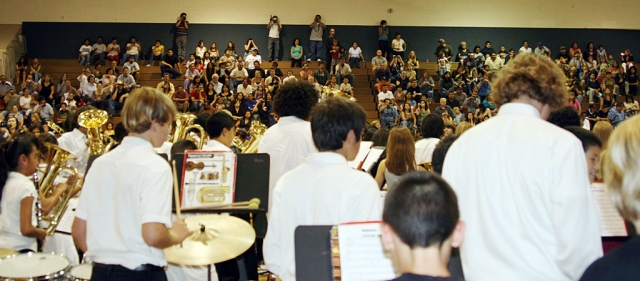 "History was made in the Fillmore Middle School gym on Monday, May 18, 2009! Elementary Schools Band Director Juliette Resor, Art Teacher Doris Nichols and Middle School Band Director Greg Godfrey presented the first ""FUSD Elementary Schools and Middle School Band Concert and Art Show."" The event brought together over 50 middle school art students, and 300 music students from Beginning to Advanced Band classes hailing from Piru, Sespe, Mountain Vista, San Cayetano and FMS. There was not an empty seat in the house as the appreciative crowd of over 600 family, staff and community members enjoyed the talents of our very own artists and musicians. The 300 4th through 8th graders ended the evening by standing together for the first time ever, and played the rousing ""Power Rock"" as the biggest band our District has ever enjoyed. Thank you to all who continue to support our musicians and artists with your time and presence."