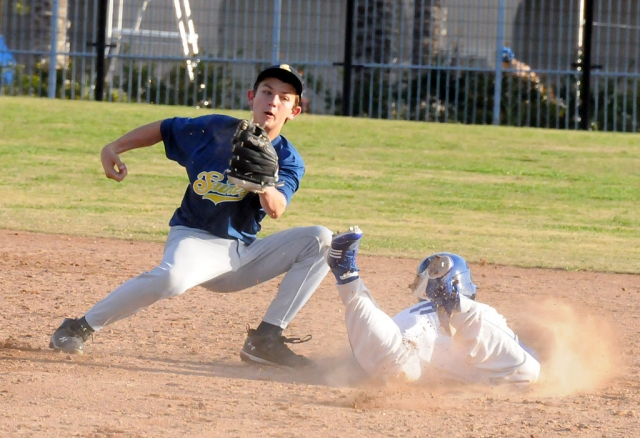 A Fillmore player slides safely into second base. Alan Lizarraga pitched 5 2/3 innings earning a win. Johnny Wilber was 2 for 3 with 2 RBI's. Fillmore won 9-3.
