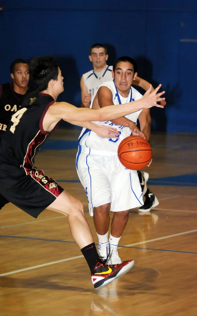 Josh Valenzuela #23 passes the ball to his teammate. Valenzuela contributed 9 points.