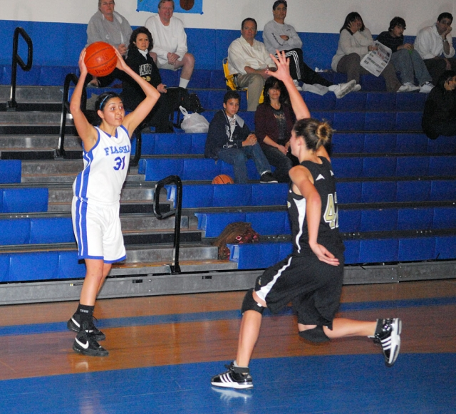 Jazzmine Galvez looks to pass the ball and keep it away from Oak Park.