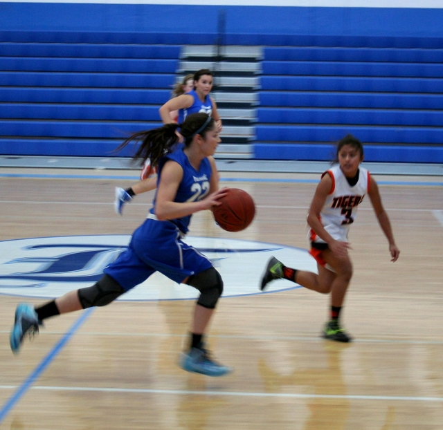 Anyssa Cabral with a fast break to score 2 points with teammate, Kayla Grove. Anyssa had 12 points, 2 rebounds and 3 steals against opponent Roseville, California.