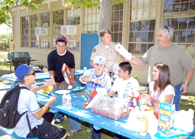 Police Chief Tim Hagel and Councilman Steve Conaway barbecued lunch for several high school kids last week.