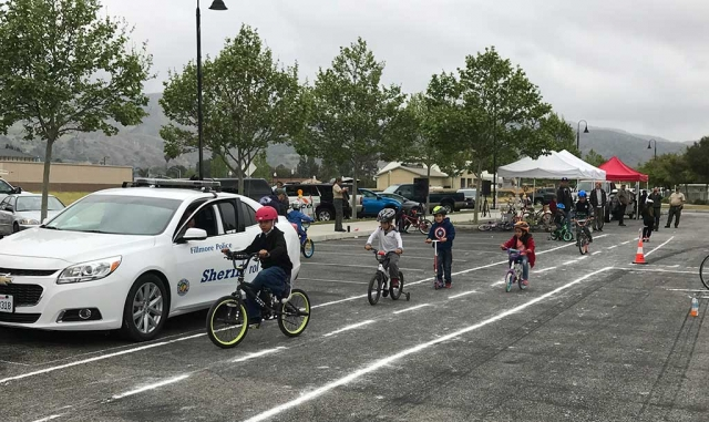 Saturday, May 12th from 9am to 12pm at Two River's Park the Fillmore Citizen Patrol, Police Department and the Santa Clara Valley Explorer Post hosted their Annual Bike and Skateboard Safety Rodeo. Kids were able to get free helmets and fitting assistants, participant in a safety course, as well as meet some of the local law enforcement personnel. Photos courtesy of Fillmore Citizen Patrol.