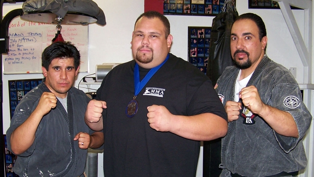 Robbie Aguilar (center) with instructors Michael Torres (left) and Sifu Paul Perce (right)