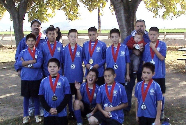From left to right top row: Coach Joe Magana, Joseph Magana, Andres Andrade, Rodolfo Garza, Gerardo Rodriguez, Gilberto Magana, Asst. Coach Juan Magana and Juan Magana. Bottom Row: Andre Alvarez, Angel Figueroa, Pete Frias and Daniel Rojas. Congratulations to the U-12 Boys-Fillmore Crushers for placing 1st in the local Fillmore AYSO division and for placing 2nd this past weekend in the county Championship held in Camarillo they fought till the end but they lost to Santa Paula 7-6; overall record was 15-1. Top scorers Joseph Magana, Andres Andrade and Juan Magana. Now they will be representing Ventura/Santa Barbara County in the Section Playoffs in Bakersfield in March. Way to go boys and Good Luck!!!