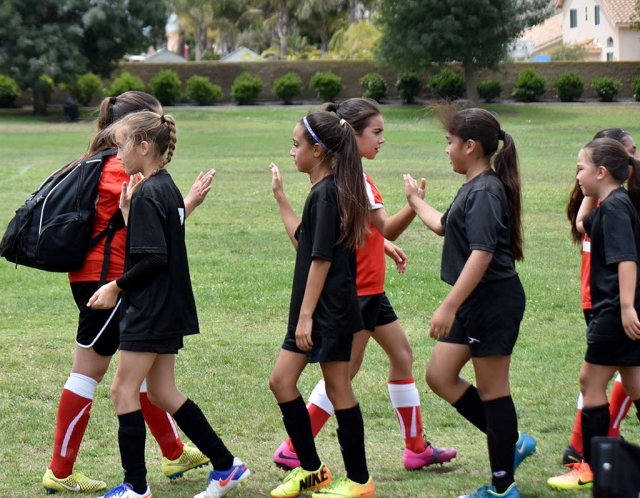California United 11-U girls are shown congratulating their opponents at the end of the game this past weekend after a great effort. Photo Courtesy Evelia Hernandez.
