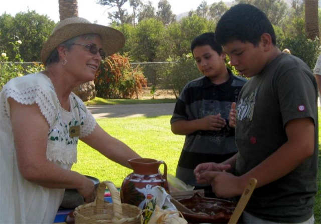 Rancho Camulos Museum docent Carmen Zermeno teaches young visitors about 19th century tortilla making, a primary staple in feeding rancho families, workers and guests.