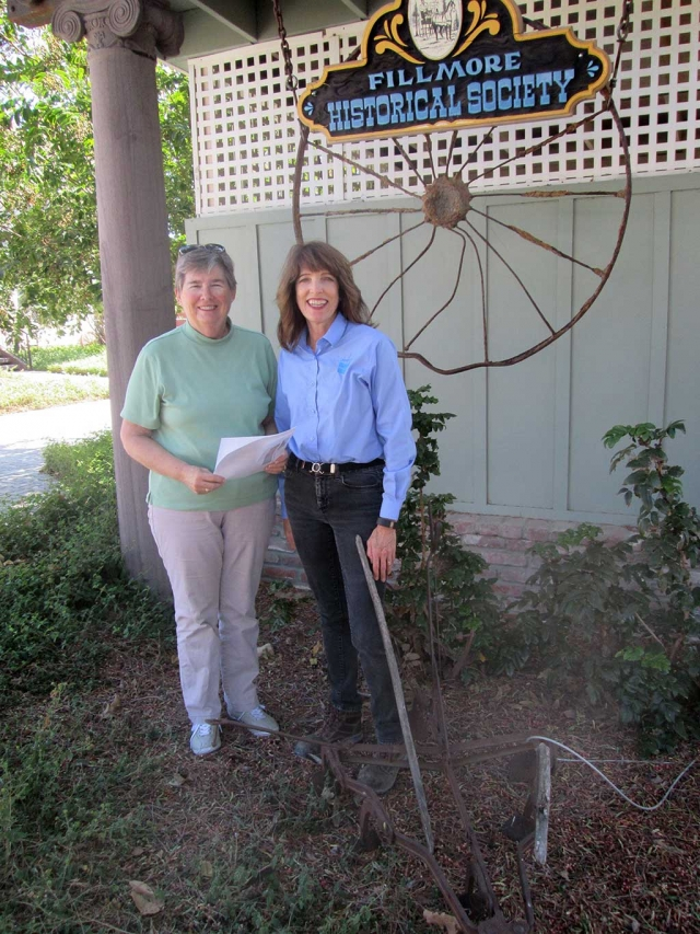 On October 6, 2015,  the Fillmore Historical Museum was pleased to accept a donation of $3,000.00 from Leslie Klinchuch representing Chevron Corporation.   The donation will be used for the ongoing projects and programs of the Museum.  The Museum currently has displays and photos representing the individuals and operations of the old Fillmore Texaco Refinery from the beginnings through WW II to its dismantling in  1951 and its final end in 2004.  The site was home for years to many of  the oil company employees and their children. The photo was taken in front of the Museum sign which is enhanced by an old wagon wheel from the turn of the last century rescued from a trash dump at the site.