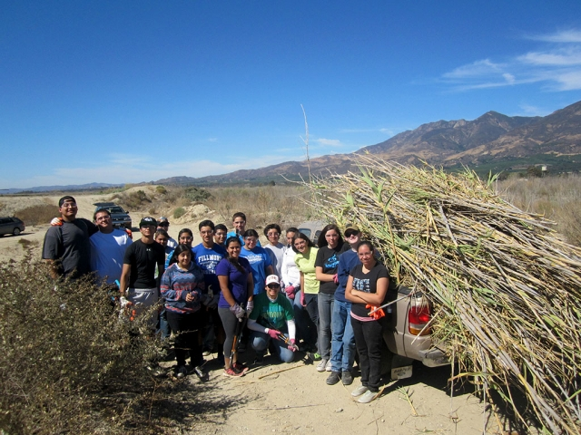 Pictured are Fillmore High and Sierra High School students, participating in the first restoration work party of the Santa Clara River habitat.