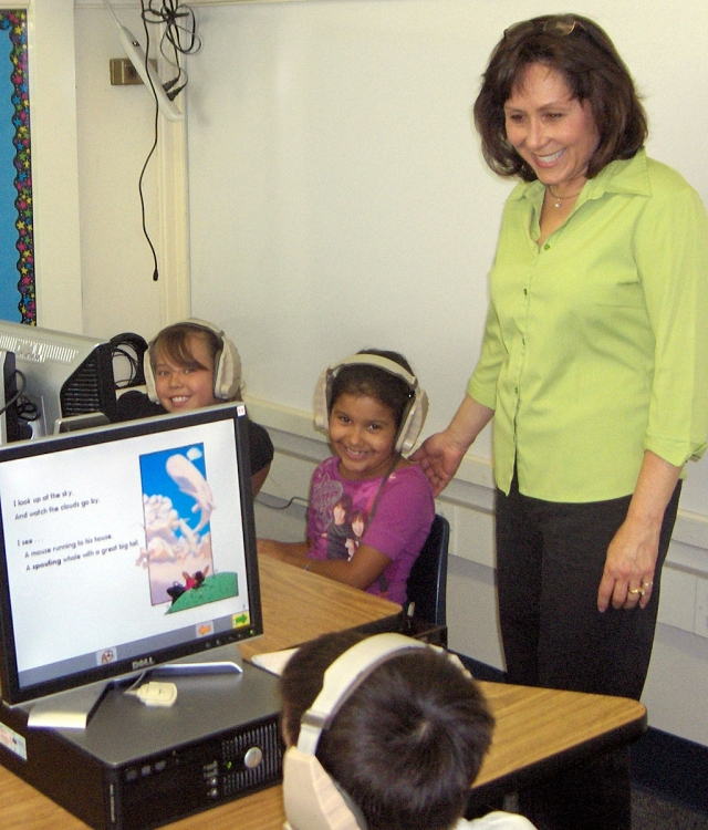 Fillmore Unified School District School Board Member, Virginia de la Piedra visited San Cayetano Elementary School on Friday September 5th. She is seen here visiting students using the Waterford Early Literacy Computer Lab. This program is for K – 2 students.