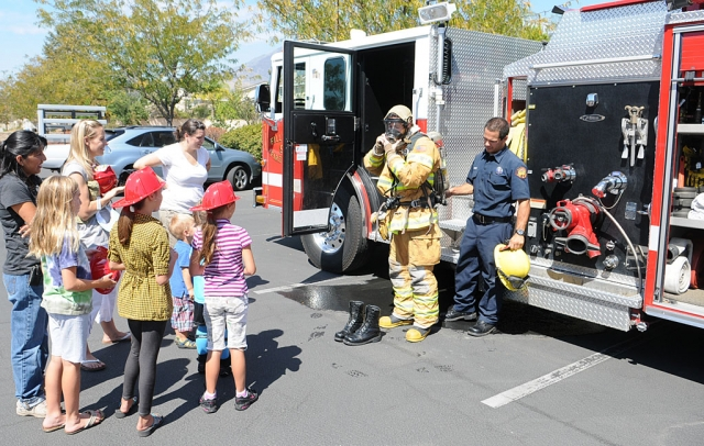 The Fillmore Fire Department demonstrates the use of fire gear to an interested audience.